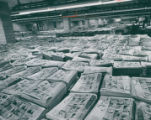 "Copies of the ""Progress Edition"" of the Akron Beacon Journal stacked in the Beacon's..."