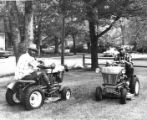Frank C. Robinson and Assistant Mowing Lawn