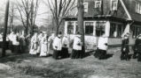 Knights of Columbus and priests parade through an Akron neighborhood